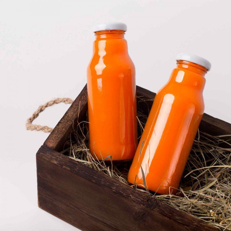 glass-bottle-with-detox-juice-of-fresh-oranges-MGMTKYD.jpg